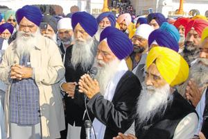 Rattan Singh Ajnala (L), Khadoor Sahib MP Ranjit Singh Brahmpura (2L) and Sewa Singh Sekhwan (R) offering prayers at the Golden Temple in Amritsar on Sunday.