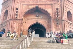 The recent addition of metal railings at Delhi's iconic Jama Masjid  looked out of place initially, yet are already merging so intimately with daily life that's it's well-nigh impossible to imagine the staircases without them.