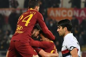 AS Roma Dutch forward Justin Kluivert (C) and AS Roma Italian midfielder Alessandro Florenzi (L) embrace AS Roma Italian midfielder Bryan Cristante after Cristante scored the 3-2 goal during the Italian Serie A football match AS Roma vs Genoa on December 16, 2018 at the Olympic stadium in Rome.