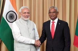 This handout photograph shows new Maldives President Ibrahim Mohamed Solih (R) shaking hands with Indian Prime Minister Narendra Modi during Solih