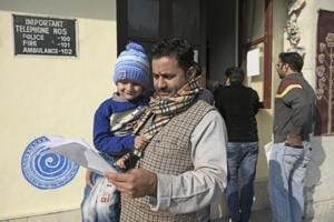 Parents getting nursery admission forms at Happy Public School, Daryaganj, in New Delhi on December 15.