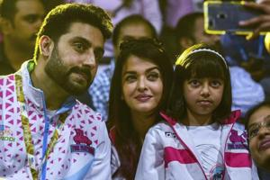 A fan takes a selfie with Bollywppd actors and owner of Jaipur Pink Panthers Abhishek Bachchan and Aishwarya Rai Bachchan during the Pro Kabaddi league season 6 match between Jaipur Pink and Mumbai.