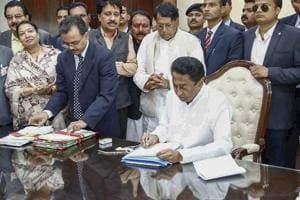 Madhya Pradesh chief minister Kamal Nath signs the farm loan waiver file after assuming office.