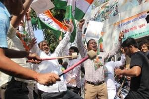 Congress workers celebrate after results of the assembly elections in Rajasthan, Madhya Pradesh and Chhattisgarh at the party office in Mumbai on December 11.
