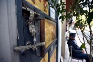 A sealed door seen after a sealing drive at Defence colony market, in New Delhi,