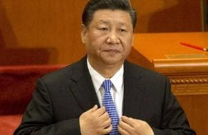 """Chinese President Xi Jinping vowed Tuesday to push ahead with China's """"reform and opening up"""" but warned that no one can """"dictate"""" what it does, as the Communist Party celebrated the policy's 40th anniversary."""