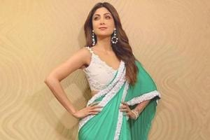 Shilpa Shetty opted to stand out in this vibrant green saree with white blouse and matching statement earrings.  (Instagram)