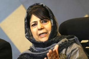 Former Jammu and Kashmir chief minister and People's Democratic Party (PDP) chief Mehbooba Mufti speaks to media during a press conference at her residence in Srinagar.