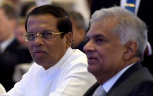 """Sri Lankan President Maithripala Sirisena (L) and Sri Lankan Prime Minister Ranil Wickremasinghe sit together during the opening of the seminar """"The Indian Ocean: Defining our Future"""" in Colombo on October 11, 2018. (Photo by ISHARA S. KODIKARA / AFP)"""