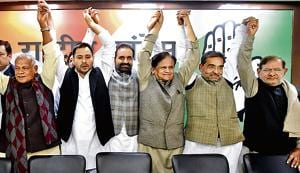 RJD leader Tejashwi Yadav with Jitan Ram Manjhi, Congress leader Ahmed Patel, AICC Bihar in charge Shaktisinh Gohil, RLSP leader Upendra Kushwaha, JD(U) leader Sharad Yadav and other leaders after joining the grand alliance during a press conference, at All India Congress Committee office (AICC), in New Delhi.