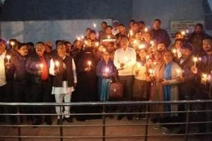 Samajwadi Party members took out a candle march in Agra to condole the gruesome killing of the school girl