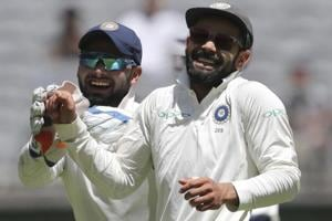 Rishabh Pant, left, and Virat Kohli share a laugh amid an Australian batting collapse during play in the second Test.