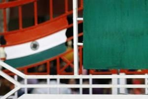 A Pakistani Ranger stands near the Pakistani flag and Indian flag (L). Image for representation.
