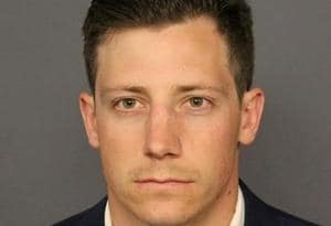 FILE PHOTO: FBI agent Chase Bishop appears in a booking photo released by the Denver District Attorney