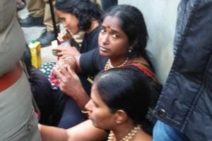 The Sabarimala foothills in Pamba on Sunday witnessed high drama as hundreds of devotees blocked paths and chased away a group of 11 women of menstruating age being escorted to the hill shrine by the police.