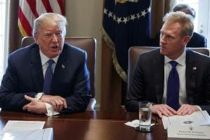 FILE - In this April 9, 2018, file photo, Deputy Secretary of Defense Patrick Shanahan, right, listens as President Donald Trump speaks during a cabinet meeting at the White House, in Washington. After Secretary of Defense James Mattis quit over Trump's announcement of a troop pullout fromSyria, Trump named Shanahan as acting secretary. (AP File Photo)