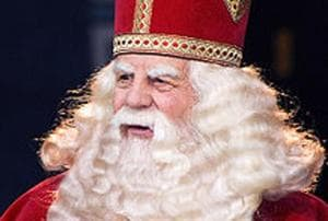 Nicholas the Bishop, famous for his good work among the poor, was cannonised in the first millennium. By the 13th century, he was a beloved figure in The Netherlands. There, St Nicholas, over time, became Sinterklaas. To this day, the official Dutch Sinterklaas (above) is a trim, bishop-ly figure in a white robe and red cape, with almost-regal long white hair and beard. He travels, incidentally, by white horse.