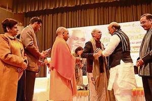 Union home minister Rajnath Singh, CMYogi Adityanath and deputy CM Dinesh Sharma along with other dignitaries at a kavi sammelan organised at the Scientific Convention Centre, Lucknow to mark the birth anniversary celebrations of former PM Atal Bihari Vajpayee, on Monday .