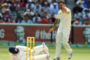 Virat Kohli is down on the ground after being hit by Mitchell Johnson.