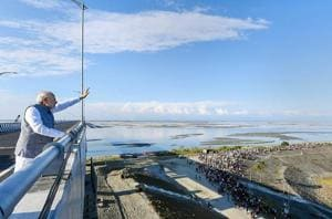 Prime Minister Narendra Modi waves at people from the Bogibeel Bridge, the longest rail-cum-road bridge on Brahmaputra river, after it was inaugurated by him, in Dibrugarh, Tuesday, Dec. 25, 2018. PM Modi also flagged off two new Intercity Express trains connecting Tinsukia and Naharlagun via the Bogibeel Bridge.