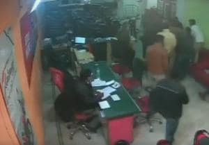 A group of men entered the spot and started beating the man inside a motorcycle showroom in Delhi.