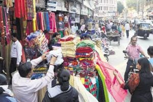 Illegal hawkers are spotted outside garment shops on Tilak road. According to the guidelines issued by the Pune Municipal Corporation hawkers or small food stalls cannot be set up in the space outside established shops.