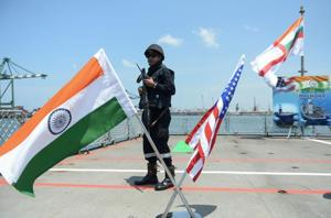 An Indian Navy sailor stands guard on the deck of the INS Shivalik during the inauguration of joint naval exercises with the United States and Japan in Chennai on July 10, 2017.