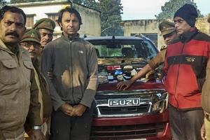 Golfer Jyoti Randhawa (2nd from left) arrested on charges of poaching in the Dudhwa Tiger Reserve protected area, in Bahraich district.
