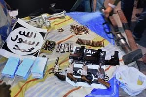 A video garb shows several weapons and a cache of ammunition which were recovered by the National Investigation Agency (NIA) during its raids at 17 locations in connection with its probe into a new Islamic State-inspired module in New Delhi on December 26.