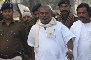 Convicted suspended RJD leader Raj Ballabh Yadav coming from court after the Civil Court sentenced him to life imprisonment in connection with the raping a minor girl, in Patna
