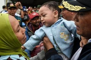 Photos | Picking the pieces: Rescue operations after Indonesia's tsunami
