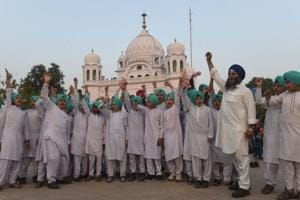 Sikh children shout slogans in front of the Kartarpur Gurdwara Sahib after a groundbreaking ceremony for the Kartarpur Corridor in Kartarpur on November 28, 2018.  Pakistan Prime Minister Imran Khan launched the groundbreaking ceremony of the religious corridor between India and Pakistan. (File Photo)