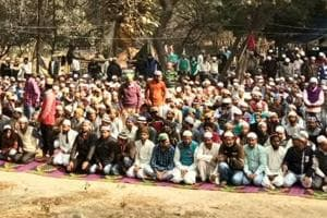 Hundreds of Muslim workers offered the Friday prayers at a saint's tomb near Sector 54.
