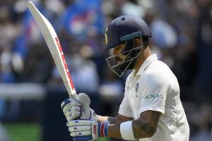 Virat Kohli enters the ground during play on day one of the third Test between India and Australia.