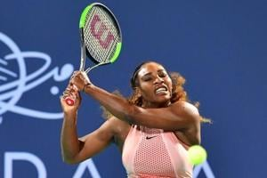 Serena Williams of the US plays the ball to Venus Williams of the US, during the 2018 Mubadala World Tennis Championship match in Abu Dhabi, on December 27, 2018