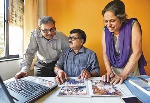 Madhav Damle (Centre) founder of Senior Citizen Live-in relationship mandal works in his office in Pune.