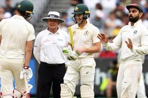 Umpire Ian Gould (L) talks to India