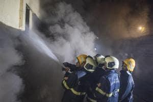 Mumbai, India - Dec. 29, 2018: Fire breaks out in Sadhana house near BDD Chawl,Worli in Mumbai, India, on Saturday, December 29, 2018. (Photo by Pratik Chorge/Hindustan Times)