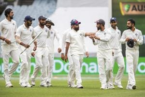 Indian team members walk off the field after beating Australia on day five of the third cricket test between India and Australia in Melbourne.
