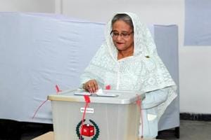Prime Minister Sheikh Hasina casts her vote in the morning during the general election in Dhaka, Bangladesh on December 30.