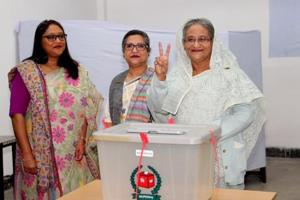 Prime Minister Sheikh Hasina gestures after casting her vote in the morning during the general election in Dhaka, Bangladesh on December 30.