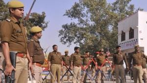 Police stand guard  in Ayodhya on Saturday November 24.