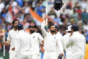 Indian players celebrate after winning the third Test against Australia in Melbourne.