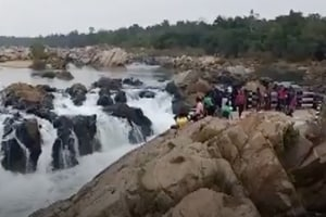 Screengrab of the video of the incident shot by the bystanders. A boy taking a selfie died after he fell into a waterfall in Odisha while he was trying to take a selfie