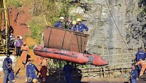 Indian Navy personnel come out of the coal mine in Ksan, Meghalaya, where at least 15 miners are stuck in a deep mine.