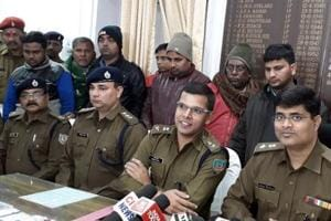 Jamshedpur,Jharkhand,INDIA, December 30:Jamshedpur SSP Anoop Birthare with the arrested persons as he claimed to have busted PDS scam racket embezzling food-grain by generating OTP using fake SIM cards in Jamshedpur on Sunday December 30,2018 -(Photo by Manoj Kumar/Hindustan Times)