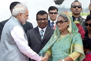 Prime Minister Narendra Modi is received by his Bangladeshi counterpart, Sheikh Hasina Wajid, at the Hazrat Shahjalal International Airport in Dhaka.