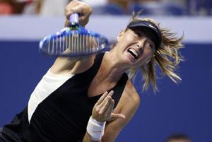 Maria Sharapova, of Russia, returns a shot to Carla Suarez Navarro, of Spain.