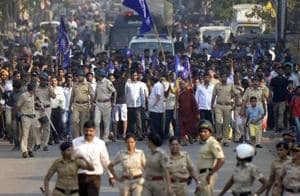 Thousands of Dalits gathered in Bhima Koregaon of Maharashtra's Pune district on Tuesday to mark the 201st anniversary of a British-era war as the administration threw a protective ring around the small village in an effort to avoid the repeat of the large-scale violence last year.