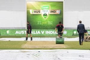 Melbourne cricket ground curators attend to the pitch before the start of play on day four of the third Test.